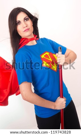 A Superhero Mom who is pretty sure she is Super and happy to keep it clean  - stock photo