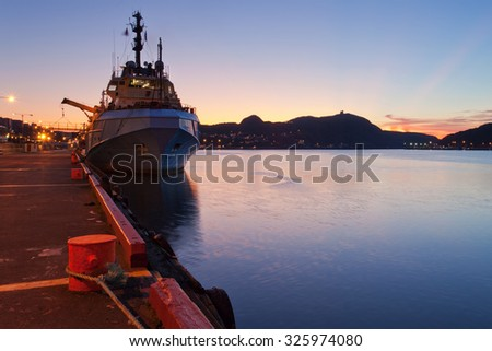 A supply vessel moored at dock. - stock photo