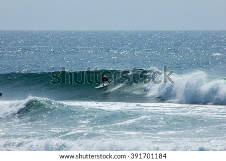 A surfer at Scottburgh beach - KwaZulu-Natal South Africa