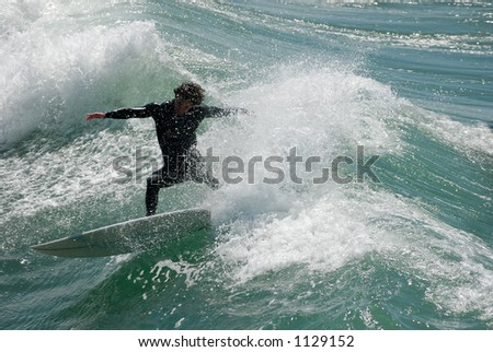 A surfer shreds the waves on the coast of California, USA