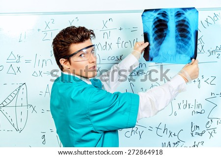 A surgeon examines X-ray of chest of a patient. Healthcare, medicine. - stock photo
