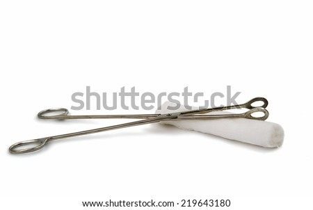 a surgical instrument with a bandage on a white background - stock photo