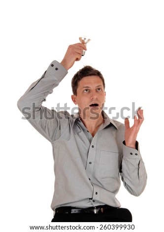 A surprised man holding up a light bulb over his head, wondering the idea he has is good, isolated for white background.  - stock photo