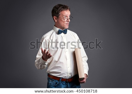 A surprised middle age man standing and wearing a bowtie