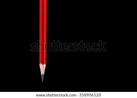 A suspended HB pencil isolated against a black background