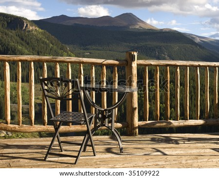 A sweeping view of forests and Rocky Mountains from the deck of a high-elevation lodge in scenic Breckenridge, Colorado. - stock photo
