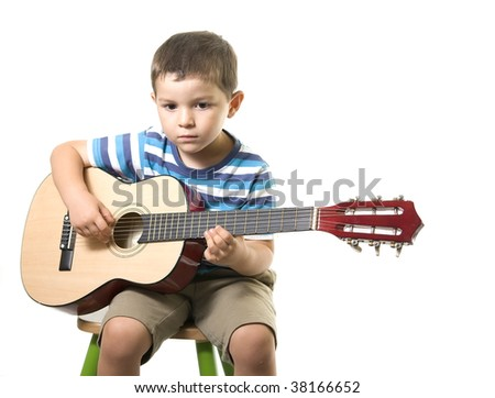A sweet boy playing guitar ( isolated on white )