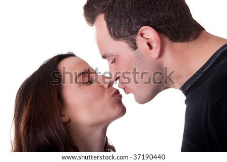 a sweet kiss between a couple isolated on a white background - stock photo