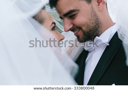 A sweet kiss. Bride and groom at the wedding