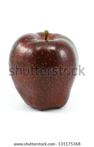 A sweet Red Delicious Apple isolated against a white background with plenty of room for text