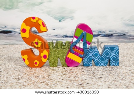 A swim sign decoration for the summer beach season