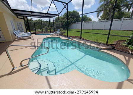 A Swimming Pool and Spa with screen - stock photo