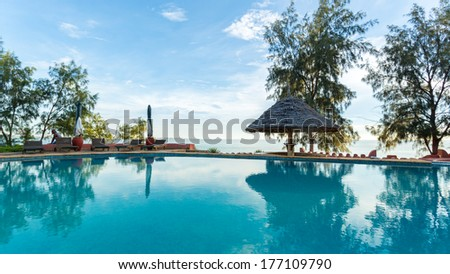 A swimming pool overlooking the Indian Ocean at a beautiful vacation spot - stock photo