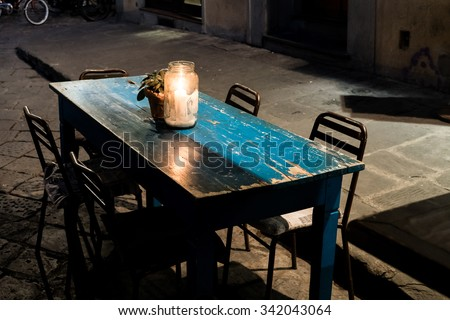 A table at a little cafe in south Florence. - stock photo