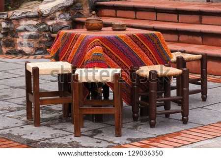 A table on the open terrace in a traditional tea cafe in Istanbul Turkey - stock photo