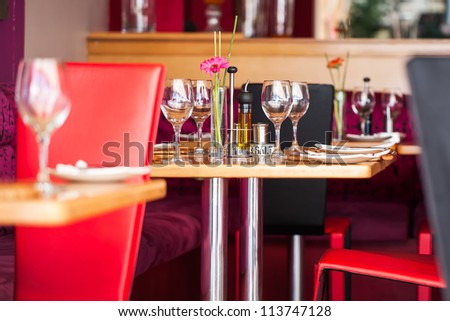 A table plated for four people at the most. - stock photo
