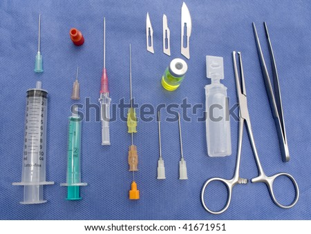 A table with a set of many surgical equipment - stock photo