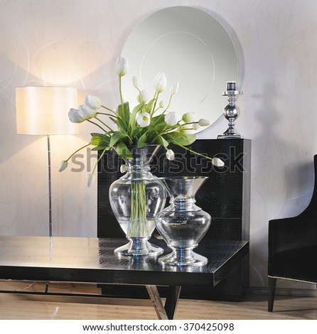 a table with vases with mirror,buffet and a lamp on a classic decoration place on a studio concept photo