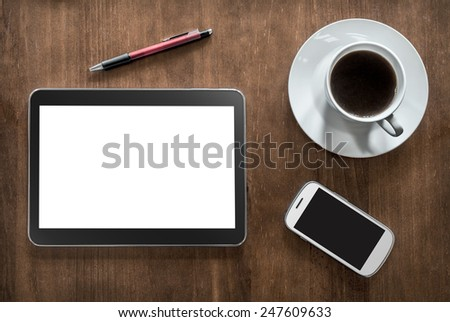 A Tablet, Coffee, A Smartphone And A Pencil On Wooden Living-Room Table