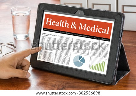 A tablet computer on a desk - Health and Medical - stock photo