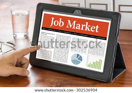 A tablet computer on a desk - Job Market - stock photo