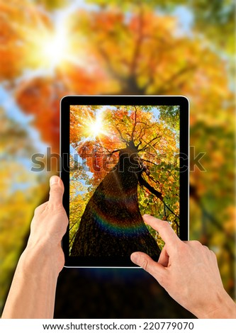 a tablet ps like ipades on the autumn backgrounds - stock photo