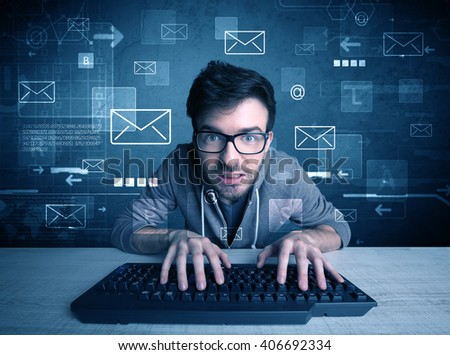 A talented young hacker hacking email address passwords concept with keyboard on desk and illustrated letters in the background - stock photo