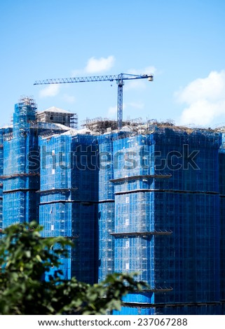 A tall building under contruction - stock photo