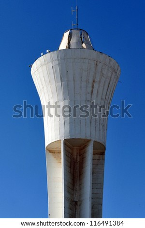 A tall city water tank tower.