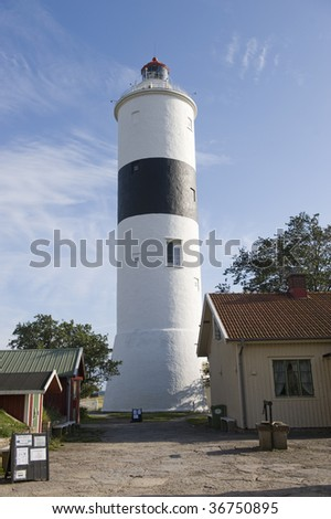 A tall lighthouse standing at Ottenby Sweden.