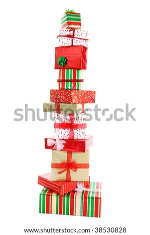 A tall tower of Christmas gifts wrapped in colorful paper and ribbons.