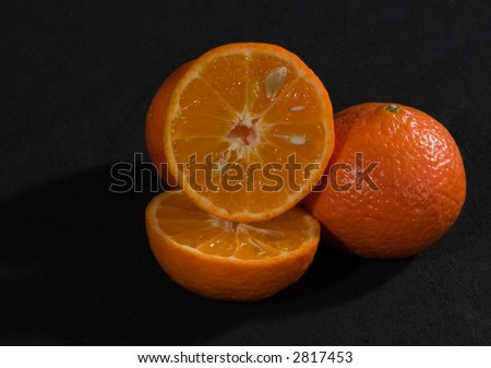 A tangerine cut in two - stock photo