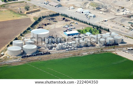 A tank farm for storing asphalt and petroleum products - stock photo