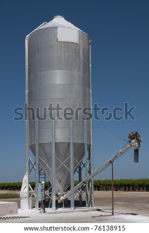 A tank holding agricultural gypsum for use on farm - stock photo