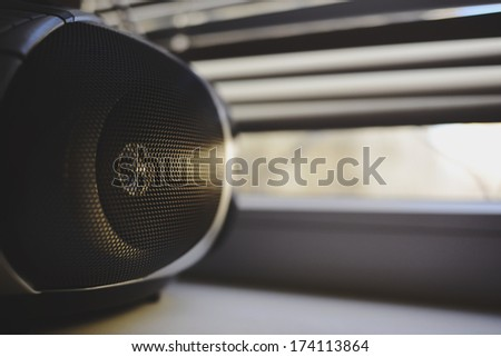 a tape recorder at sunset - stock photo