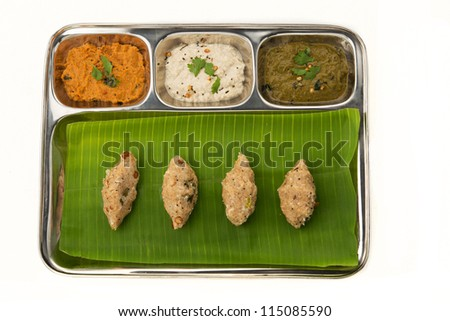 A tasty indian dish made from rice served with chutney - stock photo