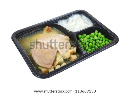 A tasty sliced turkey and vegetable meal.
