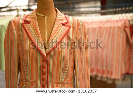 A taylors mannequin with modern jacket - garments factory, Clothes Production - stock photo
