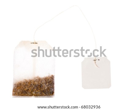 A tea bag with a blank label on a string. Isolated over white with clipping path.