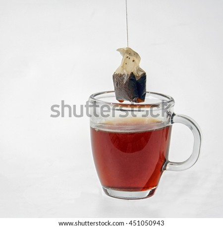 a teabag is taken out of a cup of tea