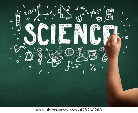 A teacher writing science, drawing chemistry elements on clean green chalkboard by hand - stock photo
