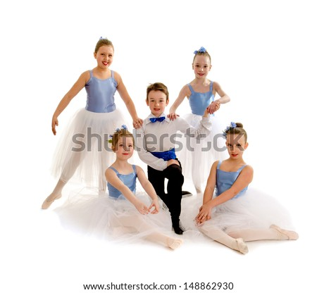 A Team of Junior Ballet Dancers in Recital Costume - stock photo