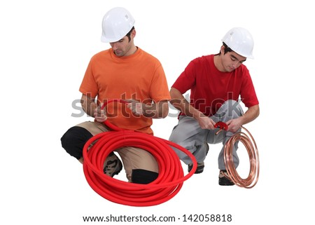 A team of tradesmen busy at work - stock photo
