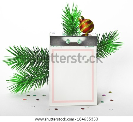 A tear-off calendar with blank page with new year decorations - stock photo