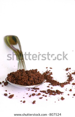 A teaspoon of instant coffee, with alot of white background to add additional own writing/pics