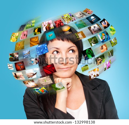 A technology woman has images around his head. Use it for a communication or tv concept. - stock photo