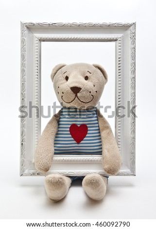 A Teddy bear with white photo frame - stock photo
