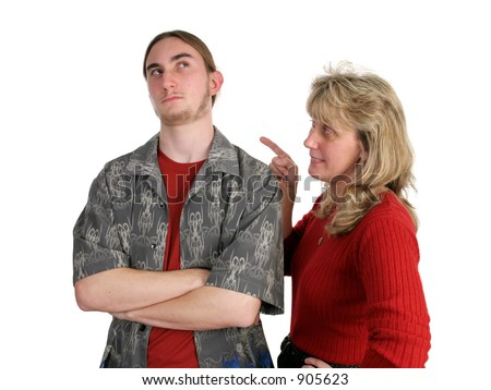 A teen boy ignoring his mother, rolling his eyes while she lectures him.