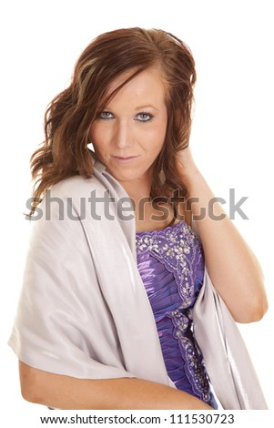 a teen girl in her beautiful purple formal with a small smile playing on her lips.