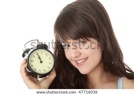 A teen woman with alarm clock isolated on white background